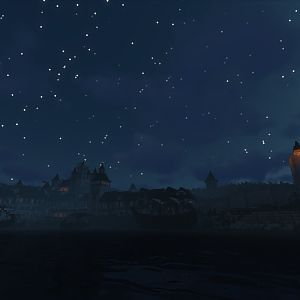 Lord Hewett's Town at night, with the Lighthouse on the town walls